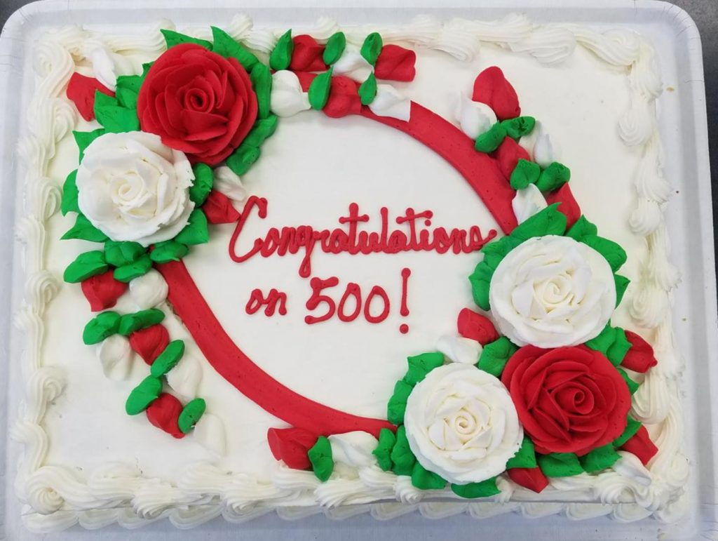 Cake with red writing Congratulations on 500