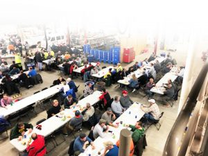 overhead view of people eating at tables for the Brats for Tots event