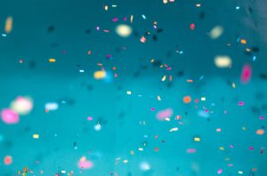 confetti falling in air on plain background