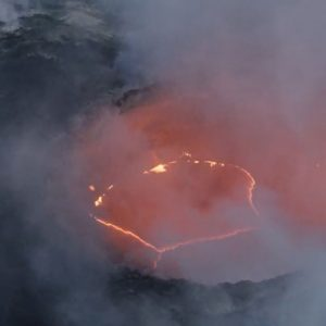 volcano opening with glowing lava and smoke