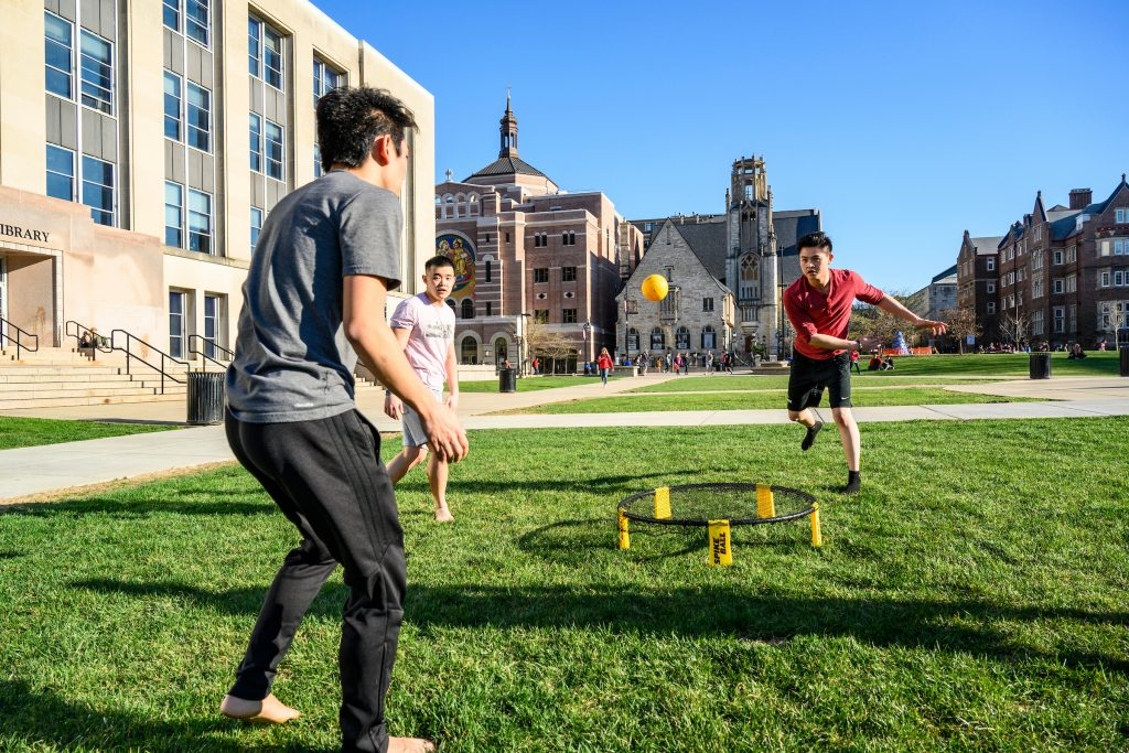 photo: students play game on the lawn at UW-Madison