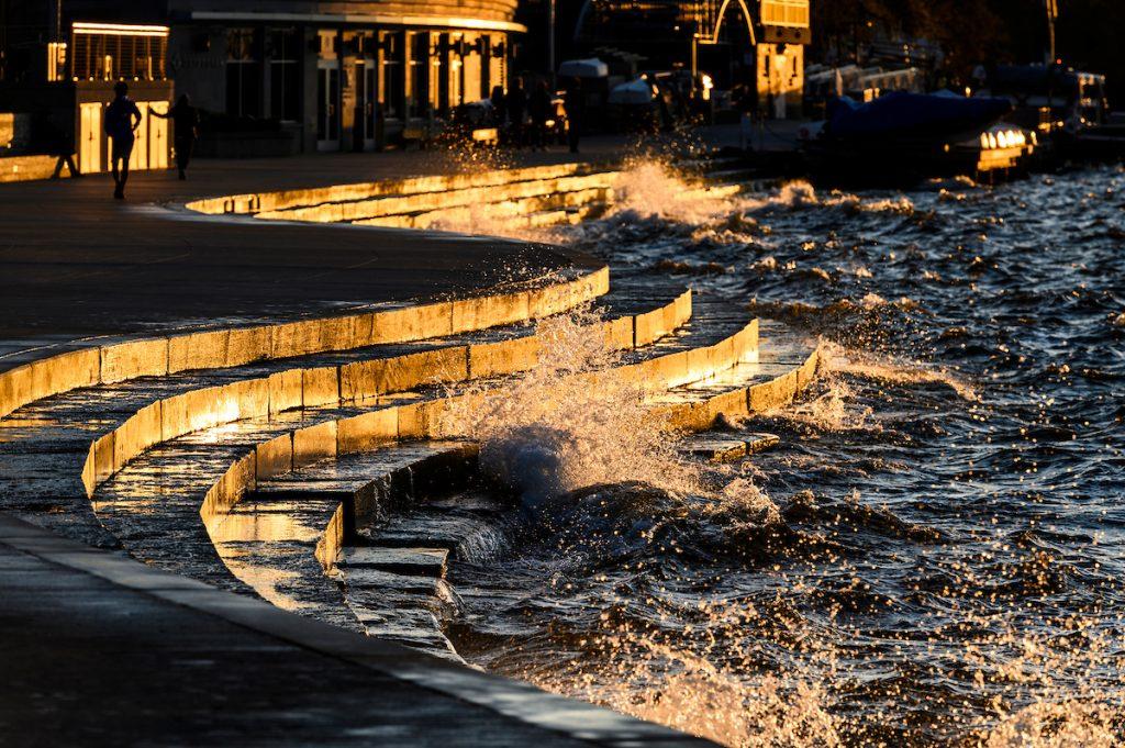 photo: shoreline with curved stone and waves crashing