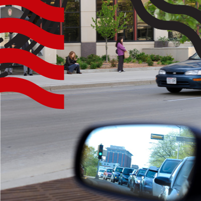 photo: rearview mirror of a car driving on University Ave.